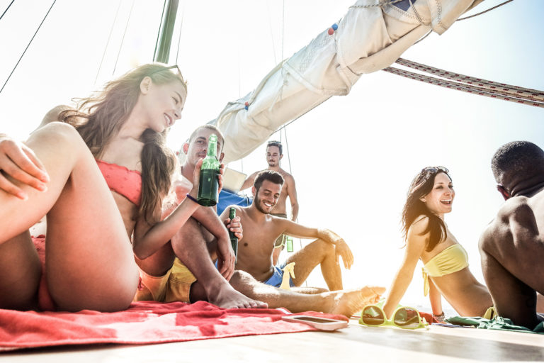 millenials on a boat party having a good time