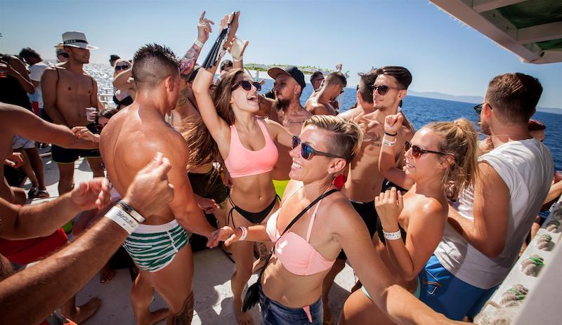 picture of a boat party under the sun