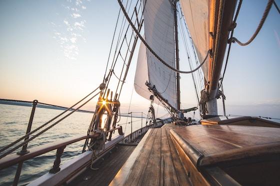 Steering a sailboat along the coastal lines