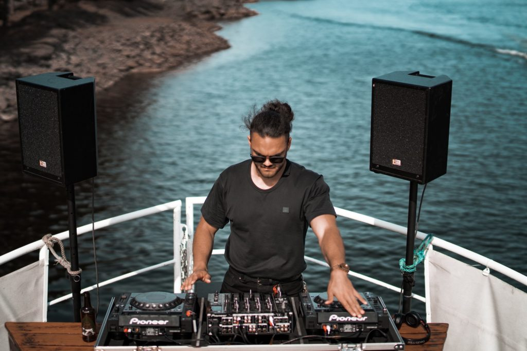 a DJ in a boat party