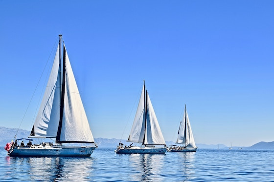 Three sailboats out at sea