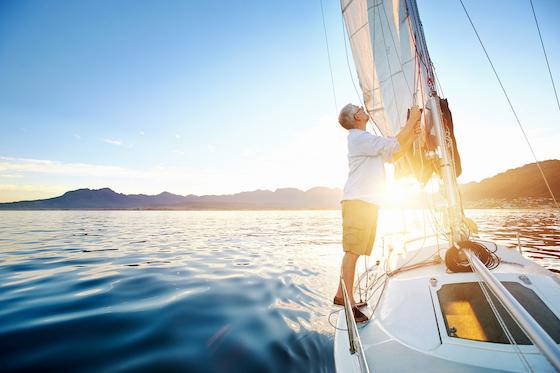 Man adjusting bow on a sailboat