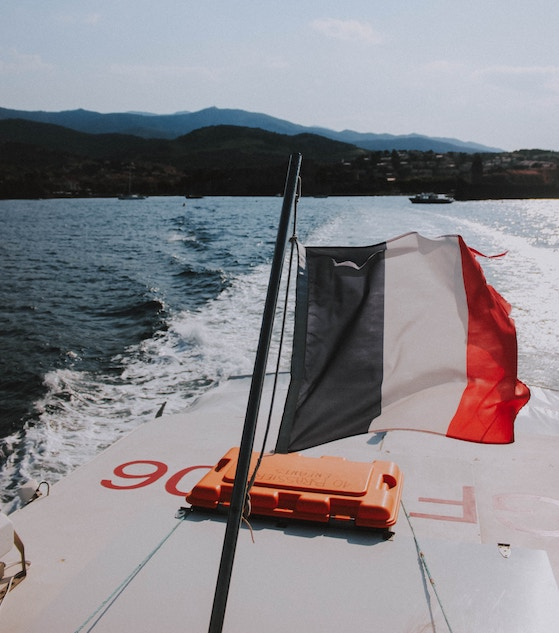French flag on the back of a motorboat
