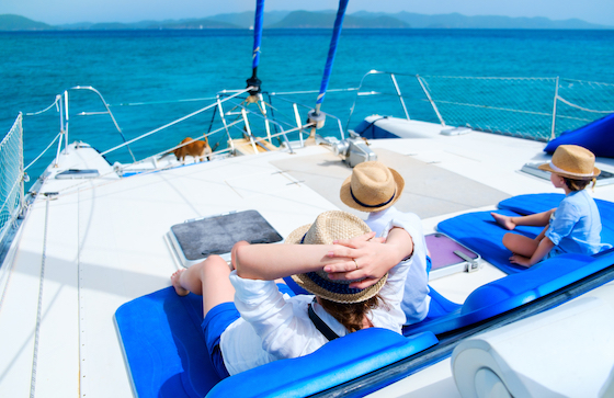 Family relaxing on a catamaran