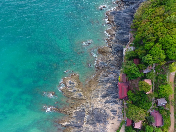 Aerial view of housing, a road and a coast in Koh Lanta, Thailand