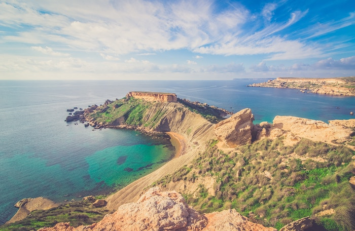 Views of the mix of clear waters and sharp cliffs in Malta