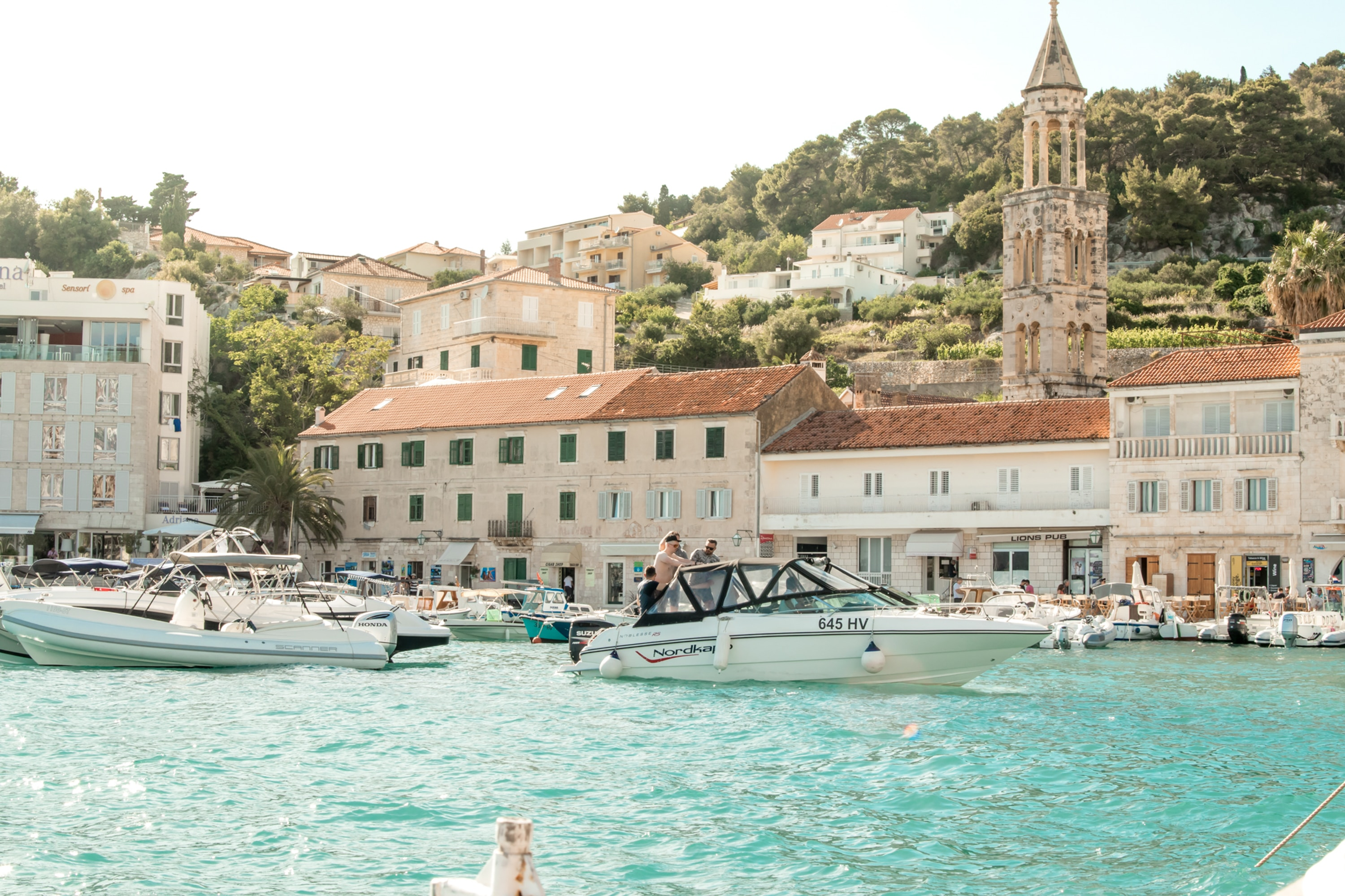 People on the boats in Hvar harbor in Croatia.