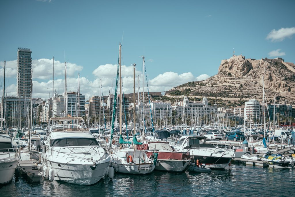 The boats in the harbour in Alicante, view on the back of Santa Barbara Castle.