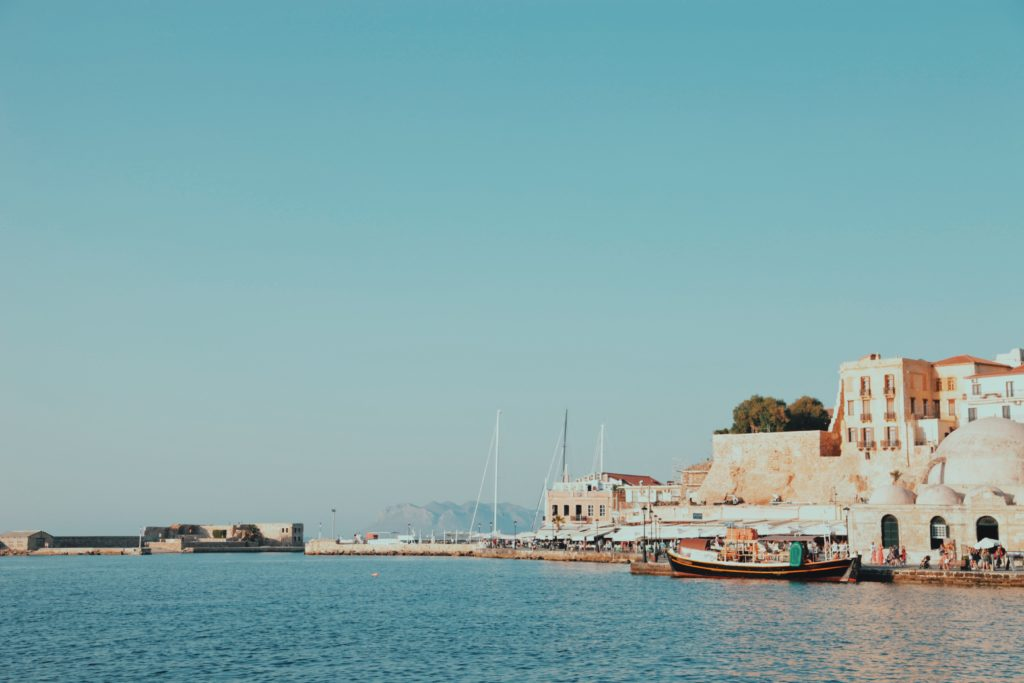 Old harbor with boats in Greece.
