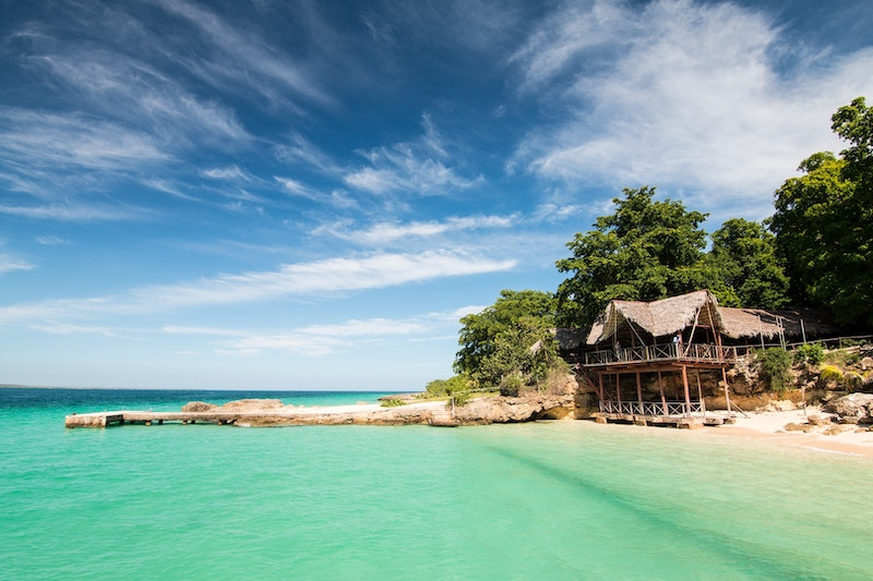 Small beach house on the coast of Cuba with turquoise green waters