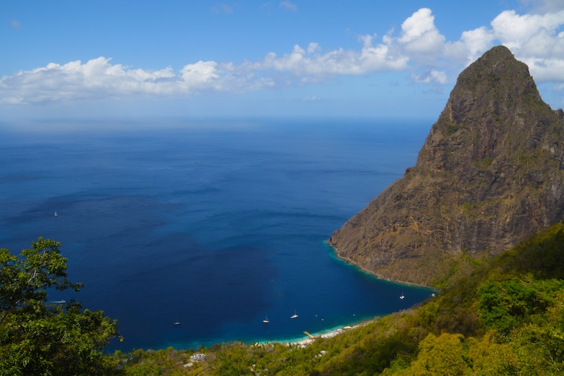 Sailboats and cliffs on the coast of St. Lucia