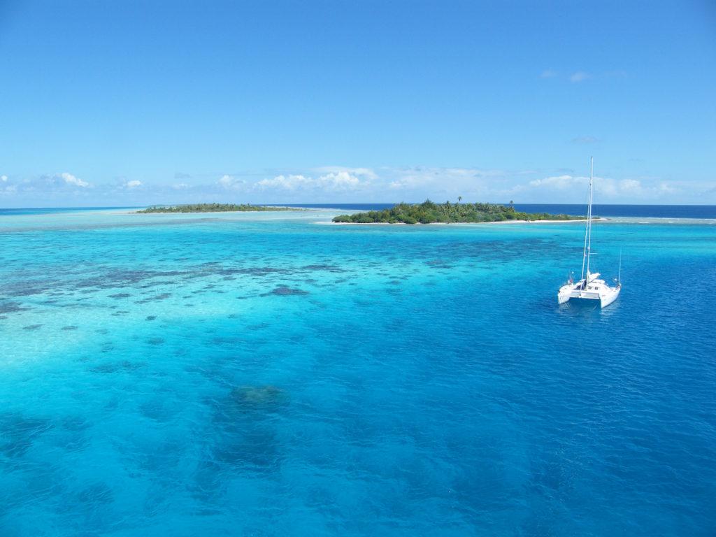A catamaran sailing through the islands in the BVI