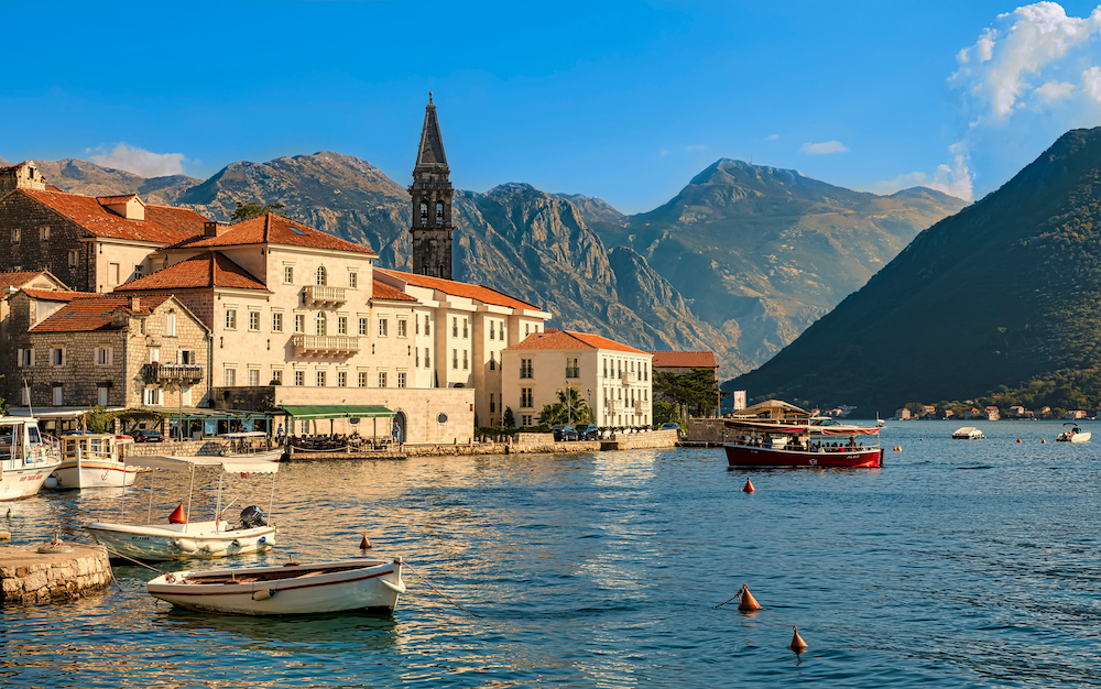 A view of Montenegro with the deep blue waters and the mountainous backdrop