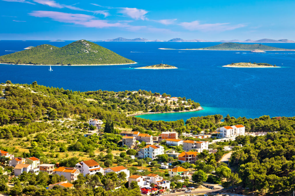 Aerial view of the Bay of Opat in Croatia surrounding with islands, boats and buildings