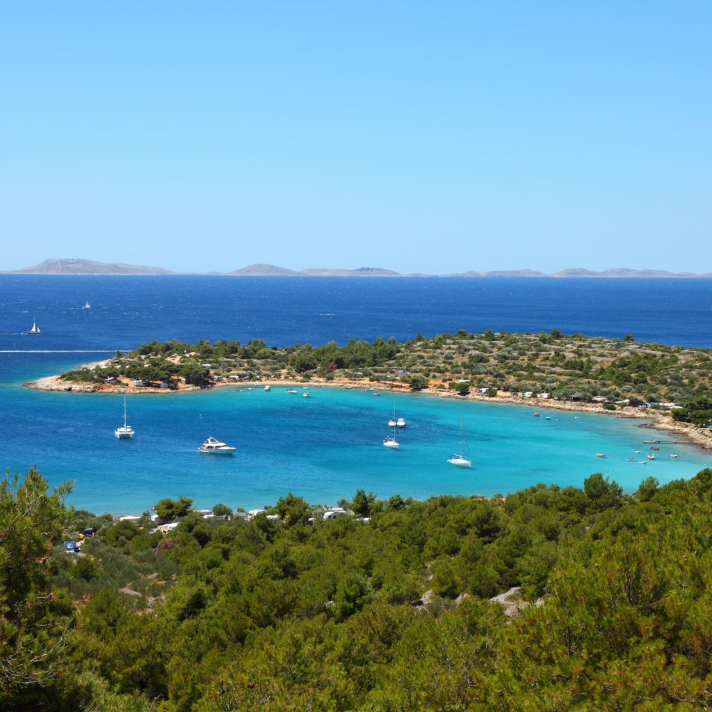 Aerial view of Murter Kornati in Croatia presenting the bay, port, trees and boats