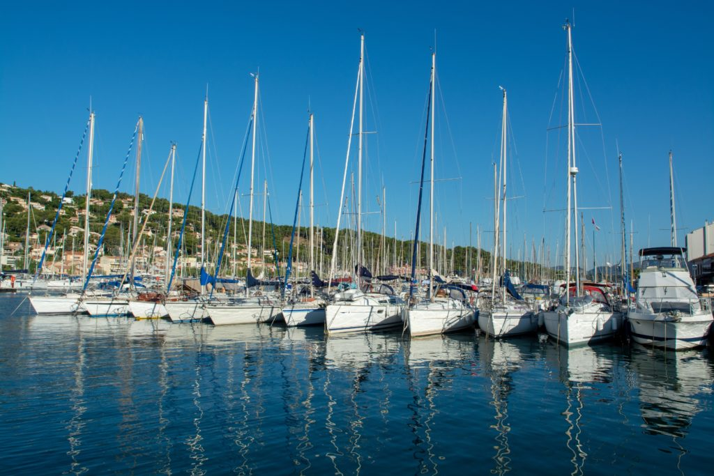 View of the port of Saint Mandrier with the anchoring sailboats