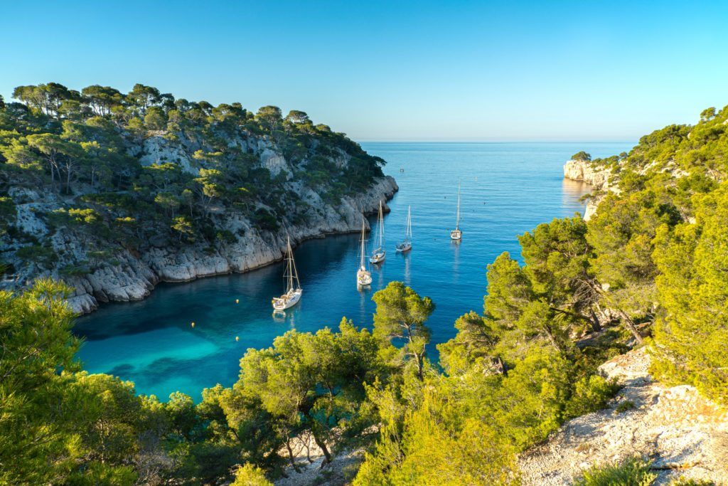 Aerial view of the bay of Cassis near Marseille and the surrounding cliffs, trees and boats