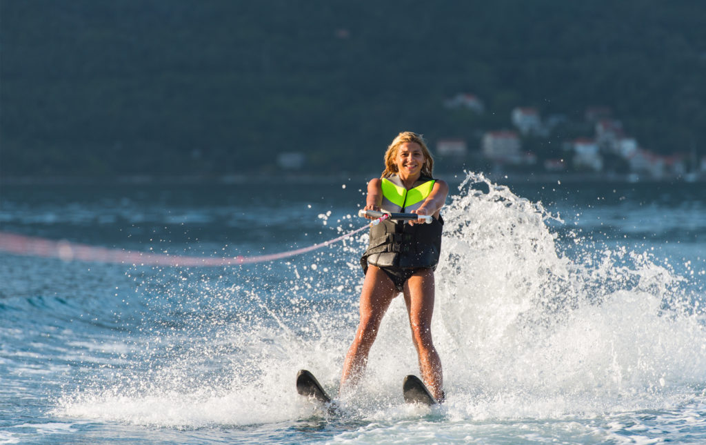 Girl water skiing on the sea