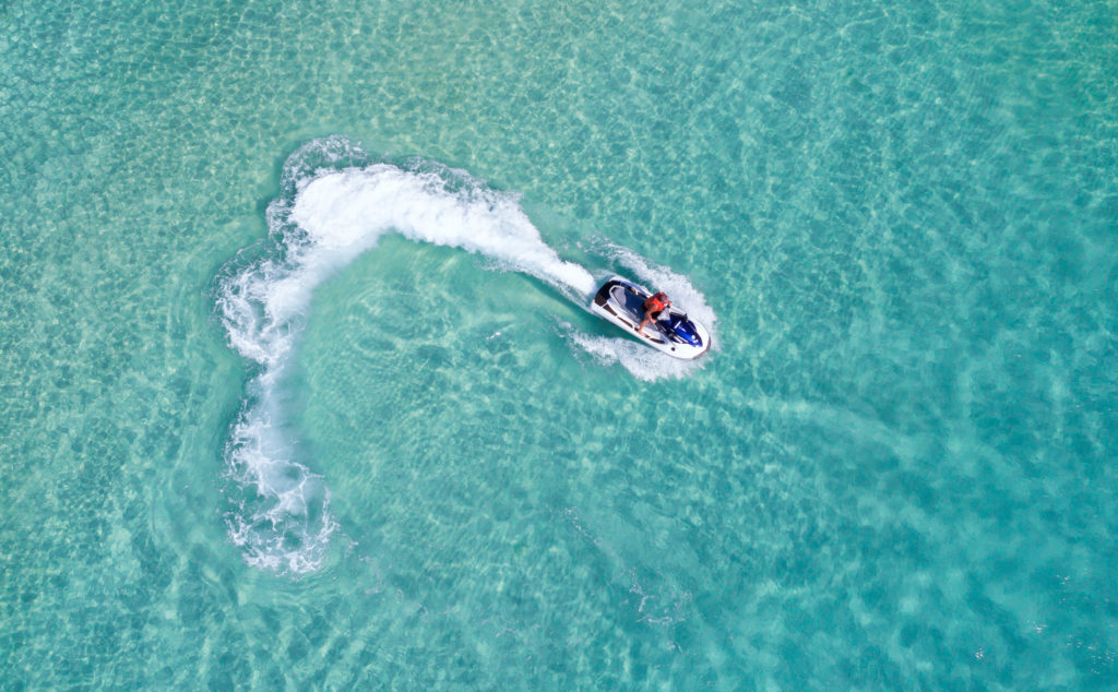 Jet-skiing in the middle of the clear blue sea