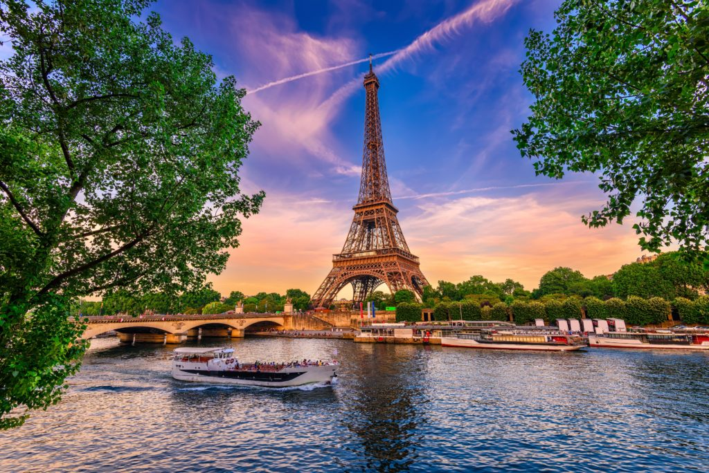 View of one of the most famous landmarks of Paris the Eiffel Tower and the river Seine
