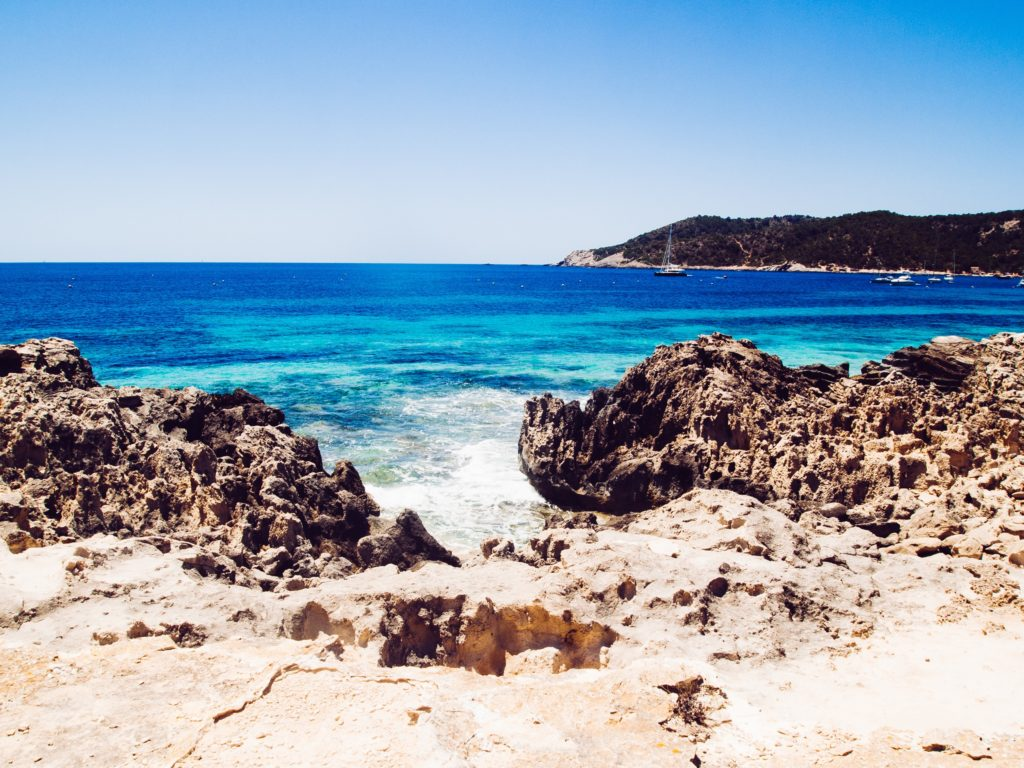 View of the Las Salinas Beach in Ibiza showing the cliffs and the clear blue sea