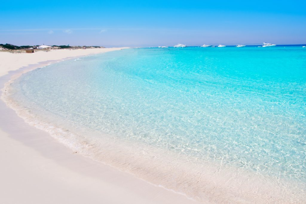 View of the Illetes beach in Formentera, showing the clear blue sea and the white sand on the beach