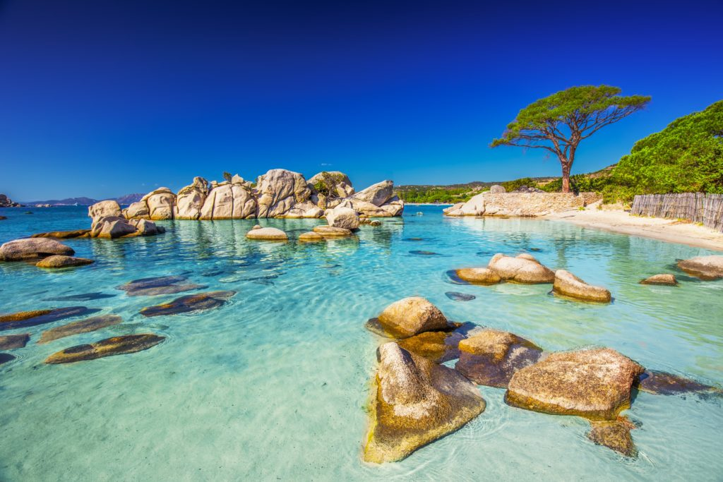 View of the rocks in the clear blue sea at Porto Vecchio in Corsica