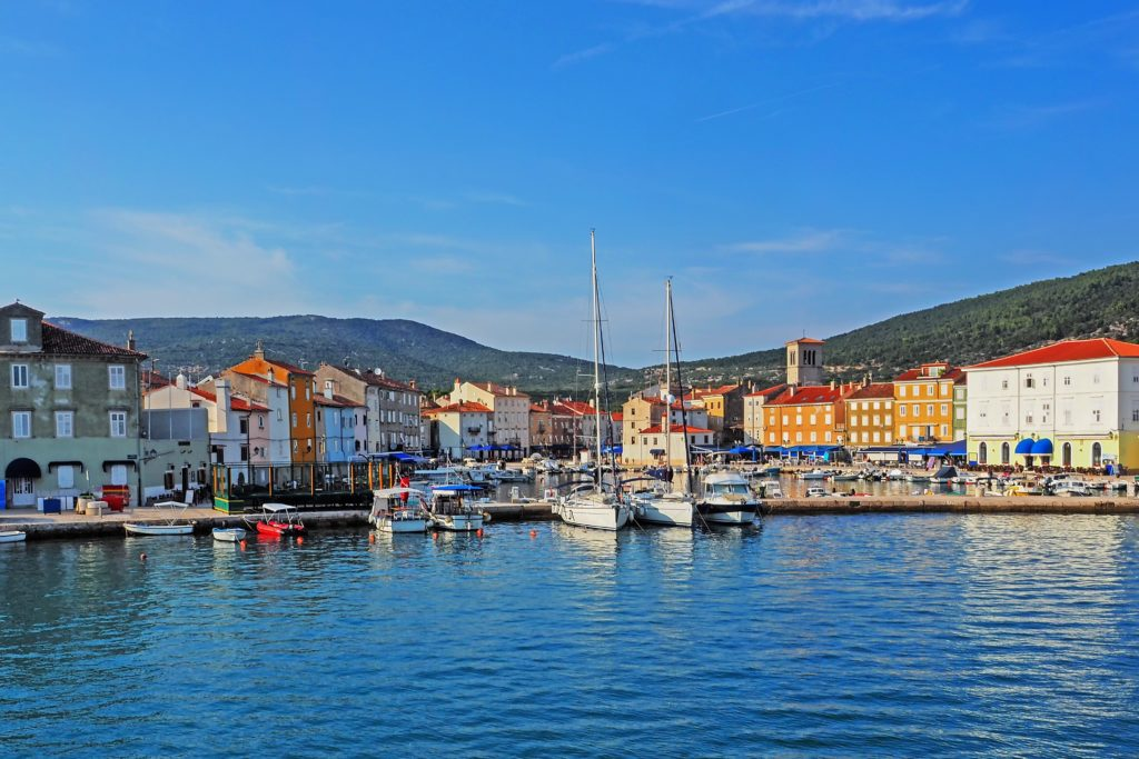 View of the port of Cres and the surrouding colourful buildings and landscape