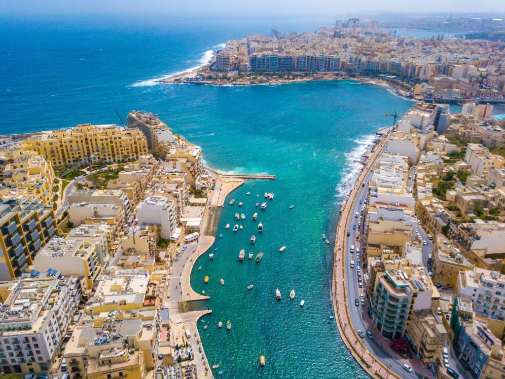 Aerial view of the Spinola Bay, St. Julians and Sliema town on Malta with the surrounding buildings
