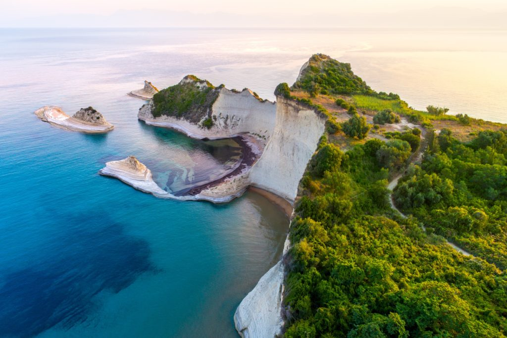 Aerial view of the cliffs and the green trees in Corfu