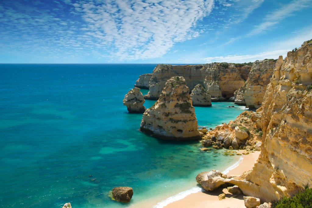 Aerial view of the Praia de Marinha in Portugal showing the stunning sharp cliffs