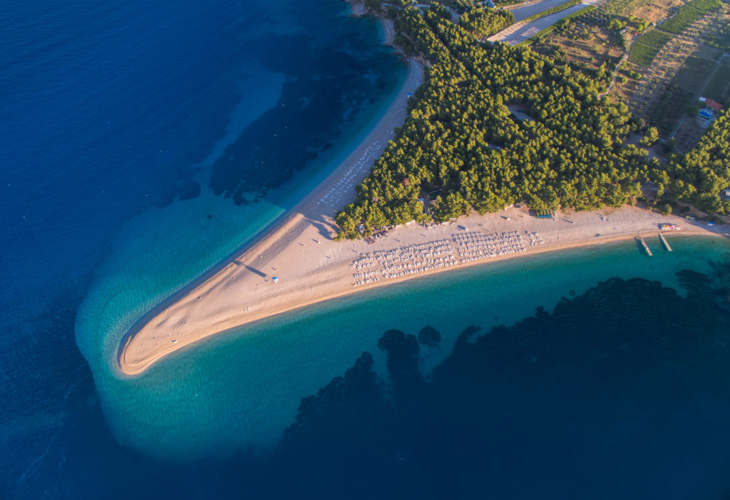 Aerial view of the unique shaped Zlatni Rat Beach in Croatia with a long sandy beach