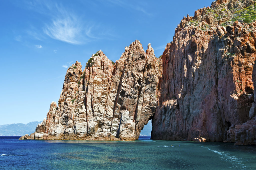 View of the unique Calanques de Piana in Corsica in the sea