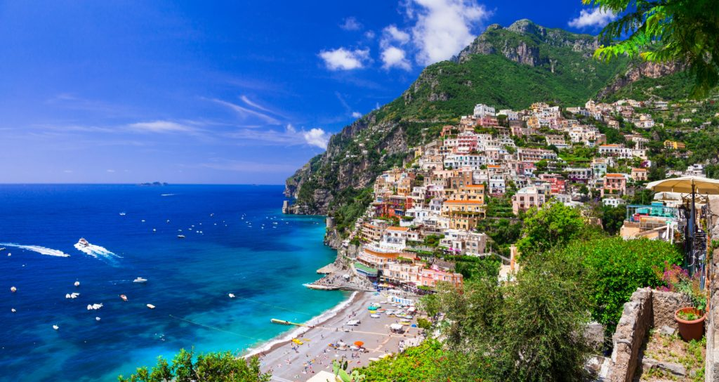 Stunning view of the Positano beach with the surrounding colourful buildings on the hillside