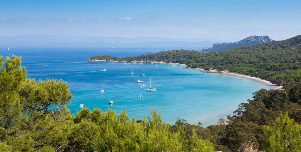 Aerial view of a bay in the island of Porquerolles with surrounding natural landscape