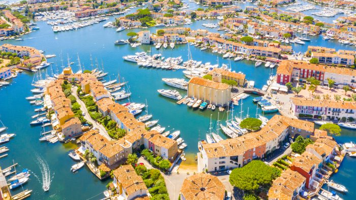 Aerial view of the port in Cogolin with plenty of boats anchoring and surrounding buildings