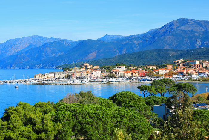 View of the Port of Saint Florent showing the mountains, the city and the greenery