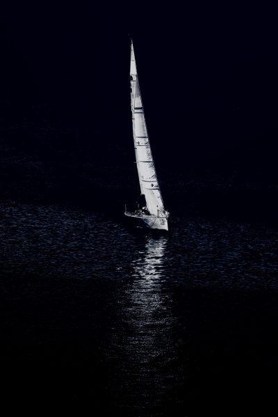 View of a sailboat sailing at night