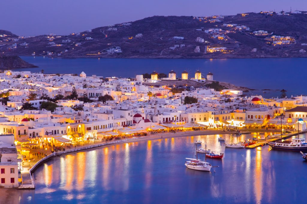 Night view of the coastline of Mykonos with the well famous whitewashed buildings
