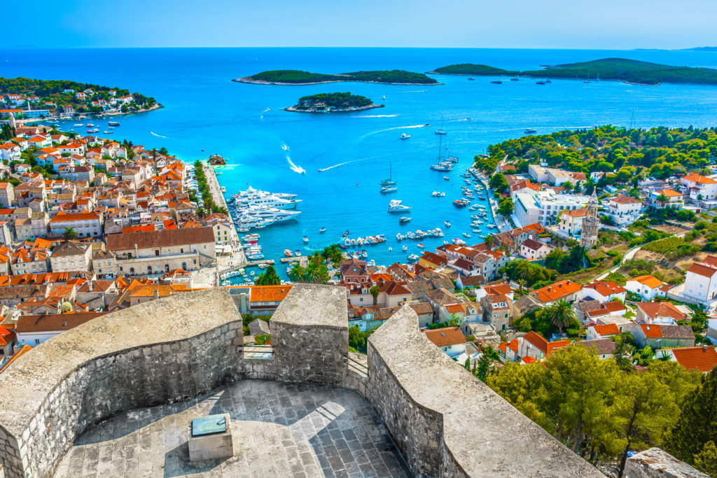 Aerial view of the port in Hvar surrounded by the buildings in the town