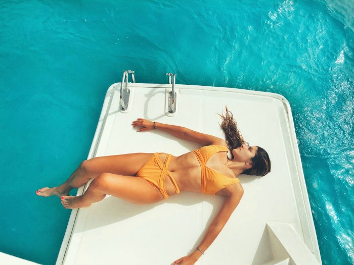 View of a woman relaxing on the boat and relaxing