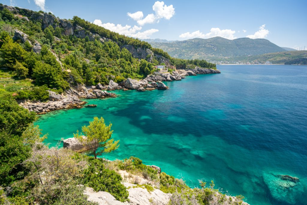Aerial view of a stunning beach in Himare, Albania