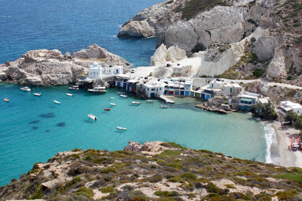 Aerial view of a bay in Milos Greece with anchoring sailboats