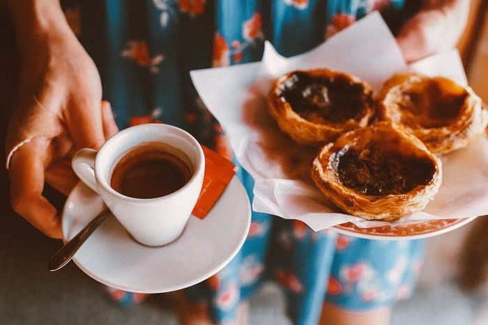 Picture of a coffe and portugese pasteries