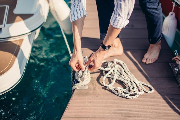 skipper making knots on sailboat