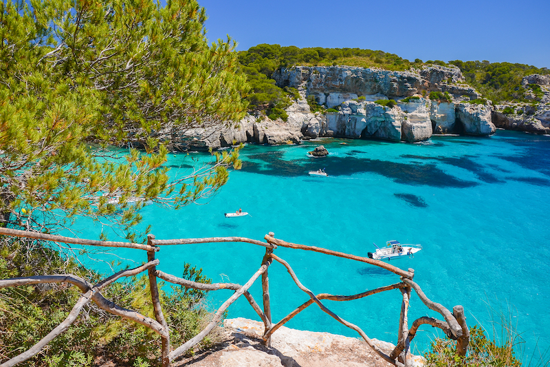 Boats sailing down the ocean in Mallorca